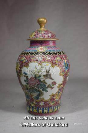 A Chinese polychrome vase and cover, with reserve panels decorated birds and prunus, 21cm.
