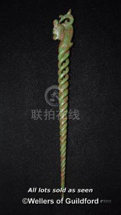 A Chinese jade hairpin with open spiral carving.