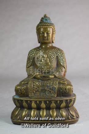 A Chinese bronze figure of a buddha seated on a lotus flower, 17cm.