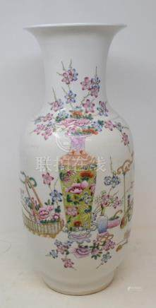 A Chinese famille rose vase, decorated a basket, a vase and flowers, 45 cm high Modern