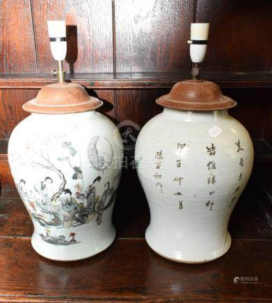 A pair of Chinese famille rose baluster vases, decorated figures and foliage, the reverse with