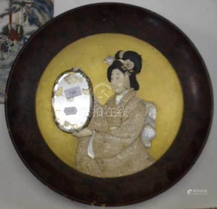 A Japanese shibayama style lacquered panel, decorated a geisha girl holding a mirror, slight loss