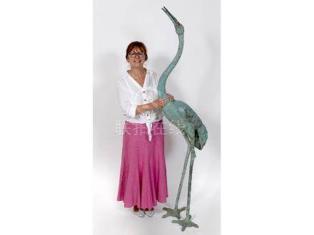 A Japanese bronze figure, of a crane, 180 cm high See illustration One foot loose, towards the