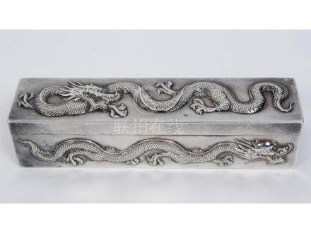 An early 20th century Chinese export silver coloured metal rectangular box, decorated in relief