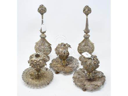 An Indian pair of silver coloured metal filigree work rosewater sprinklers, 34 cm high, another