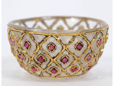 A Mughal rock crystal cup, with gem stud decoration, 4.5 cm diameter See illustration