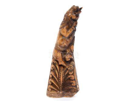 A Ceylonese bone carving/flask, carved a lion and with anthemion motifs, the protruding tongue