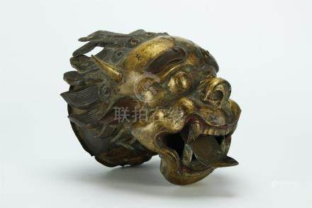 An early gilt bronze dragon head specimen