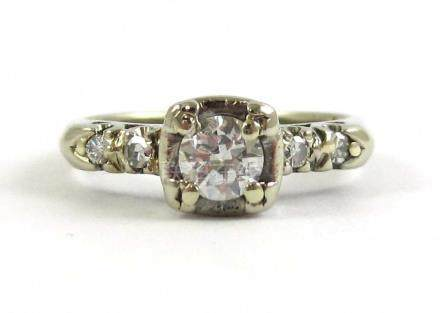 DIAMOND AND FOURTEEN KARAT WHITE GOLD RING, with a
