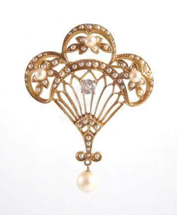 DIAMOND, PEARL AND FOURTEEN KARAT GOLD LAVALIER.