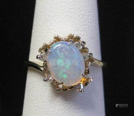 OPAL, DIAMOND AND FOURTEEN KARAT GOLD RING, with f