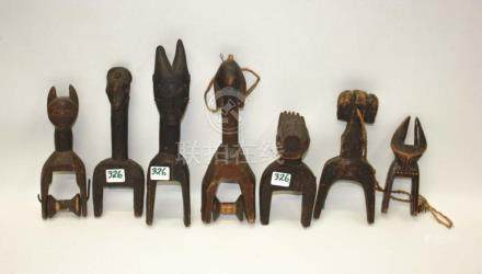 SEVEN AFRICAN CARVED FIGURAL WOOD HEDDLE PULLIES,