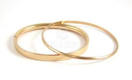 TWO FOURTEEN KARAT YELLOW GOLD BANGLES, including