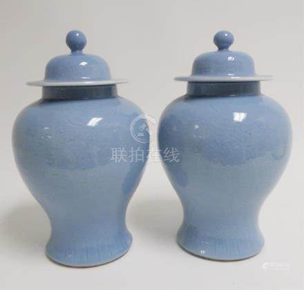 Pair of Chinese Porcelain Covered Temple Jars