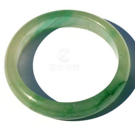 A Chinese jadeite bangle, weight 47g, 7.5cms (3ins) diameter.