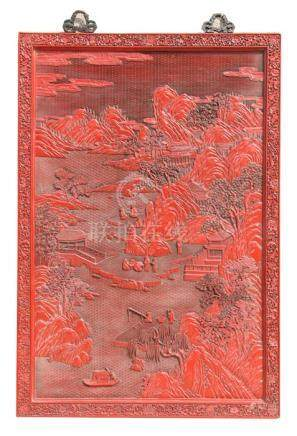 A large Chinese carved red cinnabar panel depicting a mountainous river scene within a foliate