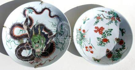 A Chinese famille verte charger decorated with a scrolling dragon holding a flaming pearl, 39cms (