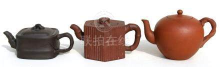 A group of three Chinese Yixing pottery teapots, the largest 18cms (7.2ins) wide.Condition Report