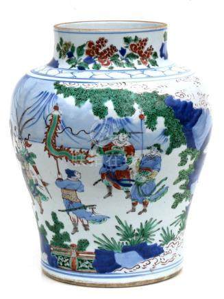 A large Chinese Doucai vase decorated with figures in a court scene, 32cms (12.5ins) high.