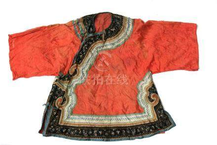 A Chinese silk embroidered short jacket decorated with a flower and butterfly border on a coral