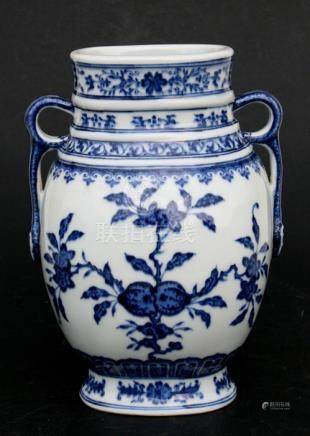 A Chinese blue & white two-handled vase decorated with fruit & foliage, blue seal mark to underside,