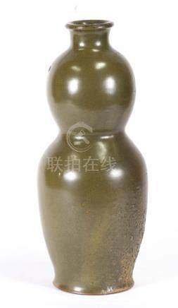 A Chinese green tea dust glaze vase, 34cms (13.5ins) high.