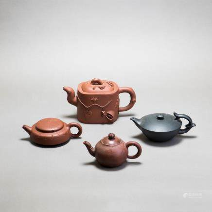 A GROUP OF FOUR YIXING ZISHA TEAPOTS