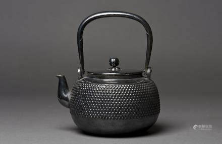 A JAPANESE SILVER BLACK TEAPOT