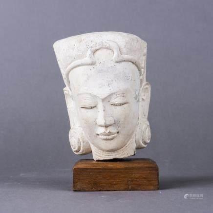 A NEPALESE CLAY BUDDHA HEAD ON WOOD BASE