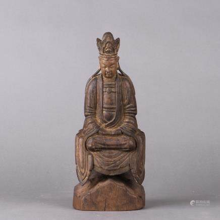 A CHINESE CARVED WOOD FIGURE OF A SEATED BUDDHA