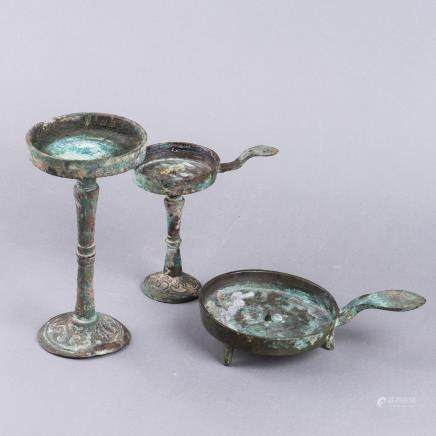 A GROUP OF THREE ANTIQUE BRONZE OIL LAMPS
