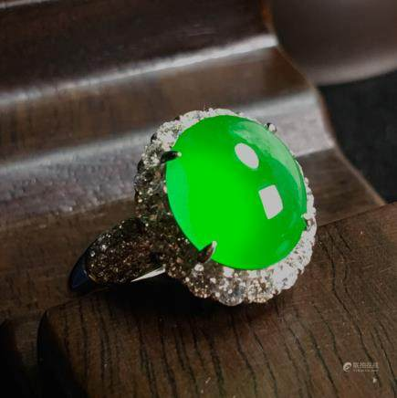 AN IMPERIAL GREEN JADEITE RING, GIA CERTIFICATE
