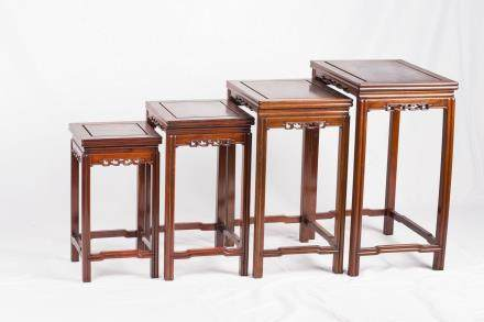 A SET OF FOUR RECTANGULAR WOOD STANDS