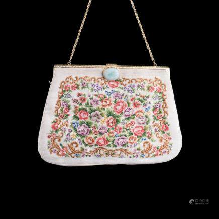 A CHINESE EMBROIDED HANDBAG MOUNTED WITH JADEITE