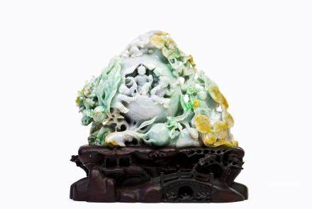 A CHINESE JADEITE CARVED WITH POMEGRANATE AND KIDS