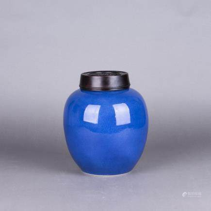 A BLUE GLAZED PORCELAIN JAR WITH HARDWOOD COVER
