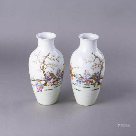 A PAIR OF FAMILLE ROSE 'KIDS' VASE
