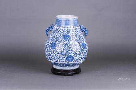 A BLUE AND WITHE VASE, ZUN