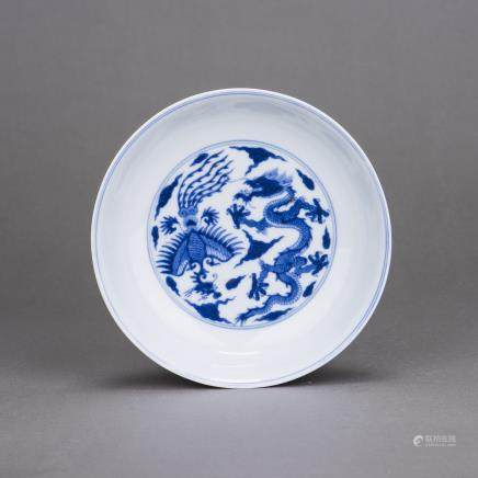 A BLUE AND WHITE 'DRAGON AND PHOENIX' DISH