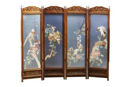 AN EMBROIDERED ROSEWOOD FOUR-PANEL SCREEN