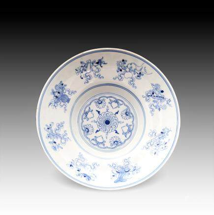 A CHINESE BLUE & WHITE BUDDHIST DISH, QIANLONG PERIOD