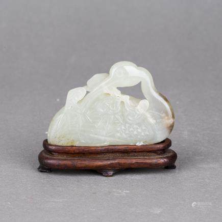 A WHITE JADE CARVING OF SWAN WITH HARDWOOD STAND