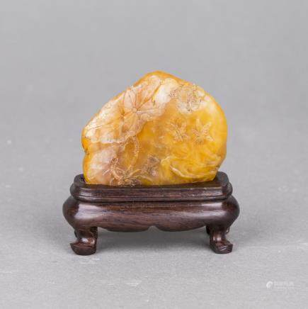 A SHOUSHAN SOAPSTONE CARVING WITH HARDWOOD STAND