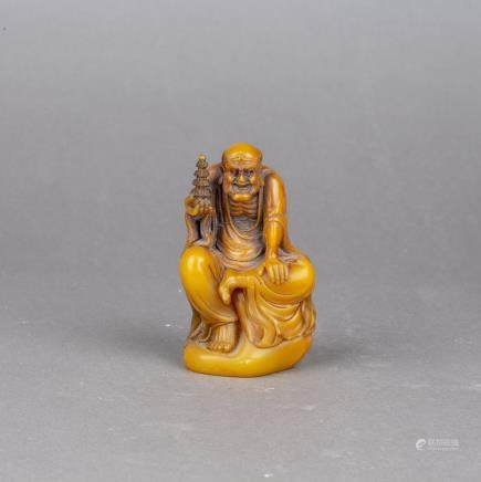 A FINELY CARVED 'HUANG FURONG' FIGURE OF LUOHAN