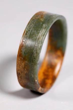 Chinese Ming / Qing Green & Russet Jade Bangle