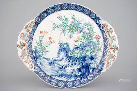 A Japanese porcelain dish decorated with a tiger, 19th C