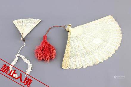 Two Chinese Canton carved and pierced ivory fans, 19th C.