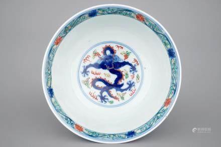A Chinese porcelain wucai dragon bowl, 19/20th C.