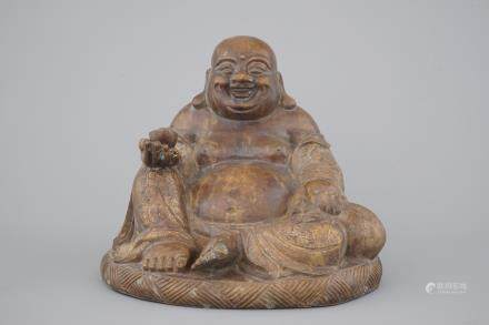 A partial gilt seated bronze buddha, Yongzheng mark, 19th C. or earlier