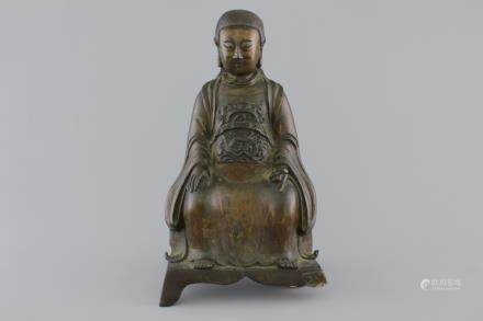 A Chinese bronze figure of an emperor on a throne, 18/19th C.
